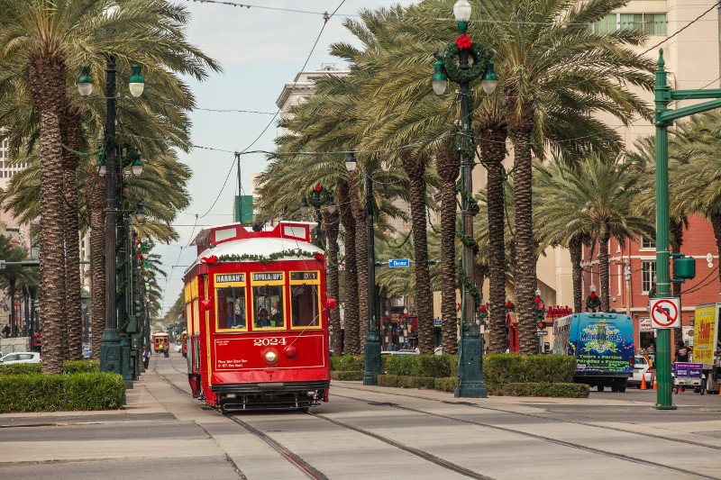 Canal Street 's red trolly decorated for Chrsitmas.